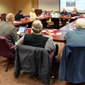 Area church leaders meet on March 14 to plan the home builds.