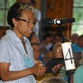 Rev. Leah Burns reads a resolution calling for an apology from Lake Junaluska during the Holston Annual Conference meeting on June 13, 2017.