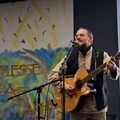 Dawud Wharnsby of the band, Abraham Jam, sings during the Interfaith Peace Conference at Lake Junaluska on March 2.