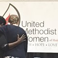 The Rev. Sandra Johnson (left) and the Rev. Patty Muse hug and pray together following Holy Communion at the Holston United Methodist Women's annual meeting.