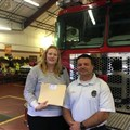 Becky Puckett and Lieutenant Steve Ebb receive Holston donations designated for the Gatlinburg Fire Department.
