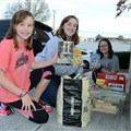 Austyn, Abigal, and Amanda Burkhalter deliver children's books to the Alcoa Conference Center on Dec. 12.
