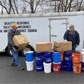 In Hansonville, Virginia, volunteers prepare to help neighbors with cleaning buckets supplied by Holston congregations.