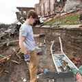 Neighborhood volunteer Rob Metcalf helps clear tornado debris in front of East End United Methodist Church in Nashville, Tenn. Photo by Mike DuBose, UM News.