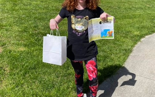 Alex proudly shows off her Easter goodie bag from Concord United Methodist Church.