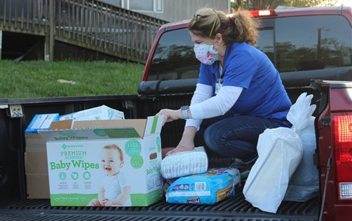 Pam Wells takes diapers, food and other supplies to a mobile-home park hit hard by tornadoes in Ooltewah, Tenn. Photo by Lisa Parker